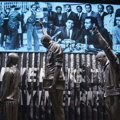 Statue of athletes making the Black Power salute at