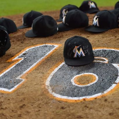 The Marlins' hats are left on the pitchers mound after