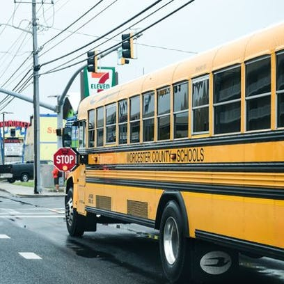 A Worcester County school bus on a stop, with its stop