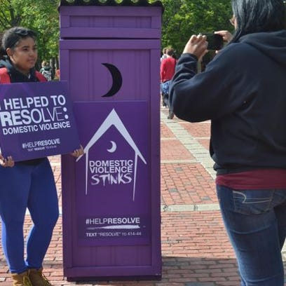 Purple outhouses are being used by RESOLVE of Greater