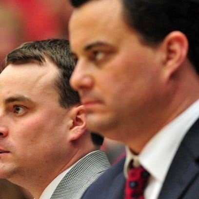 Arizona Wildcats assistant coach Archie Miller (left)