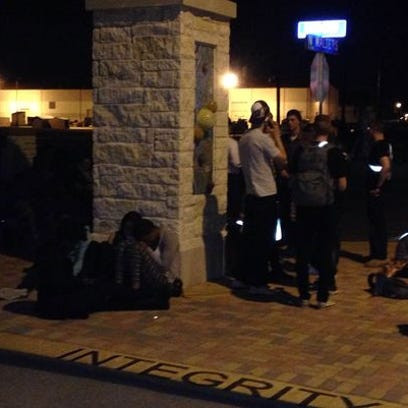 People stand outside during lockdown at Fort Sam Houston