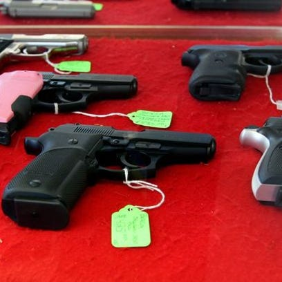 Hand guns for sale are displayed at Peters Indoor Range
