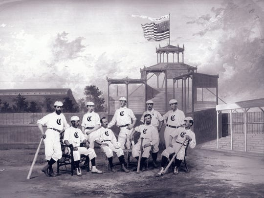 The 1868 Cincinnati Red Stockings pose for a portrait. This season, the Cincinnati Reds will wear at least 15 different styles of hats.