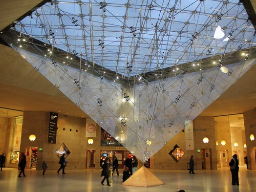 """These 10 classic museums, with the help of some of the world's best architects, created ultramodern expansions that enhance the original historic structures. """"Starchitect"""" I.M. Pei added a glass pyramid to the Louvre, Paris' iconic museum. Here, it's seen from below."""