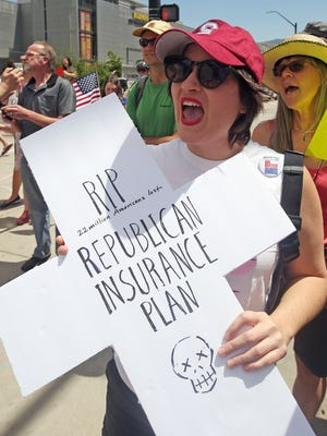Protester Mariadelmar Gonzales shouts during a protest against the Republican bill in the U.S. Senate to replace President Barack Obama's health care law June 27, in Salt Lake City.