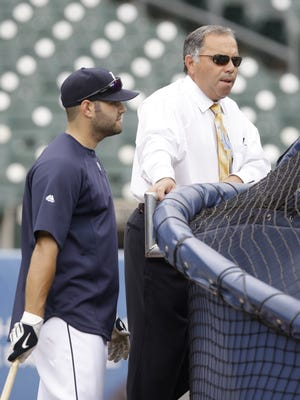 Detroit Tigers catcher Alex Avila, left, talks with his father, Al, on June 16, 2010.