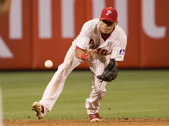 Jun 19, 2015; Philadelphia, PA, USA; Philadelphia Phillies second baseman Cesar Hernandez (16) fields a ground ball against the St. Louis Cardinals at Citizens Bank Park. The St. Louis Cardinals won 12-4. Mandatory Credit: Bill Streicher-USA TODAY Sports