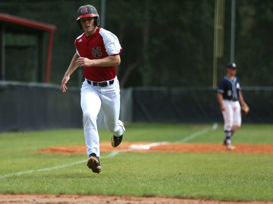 NFC's J.D. Tease sprints home to score a run against Maclay in their District 1-3A championship game last year.
