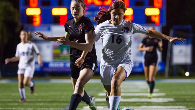 Caroline Peterson, from Barron Collier High School, and North Fort Myers High School senior, Tori Kowalczyk, chase after the ball during the Class 3A regional semifinal against North Fort Myers High School at Barron Collier High School on Tuesday, January 31, 2017 in East Naples.