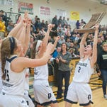 Providence Lady Pioneers forward Mikaila Heavrin holds up the IHSAA Class 2A championship trophy after their team defeated East Pekin, 53-52 06 February, 2016