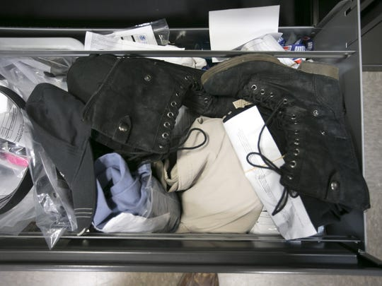 Shoes and other articles of clothing that were left behind at a TSA checkpoint at Phoenix Sky Harbor International Airport.