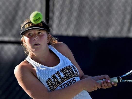 Galena's Kaija Hess hits a backhand return again Reno's