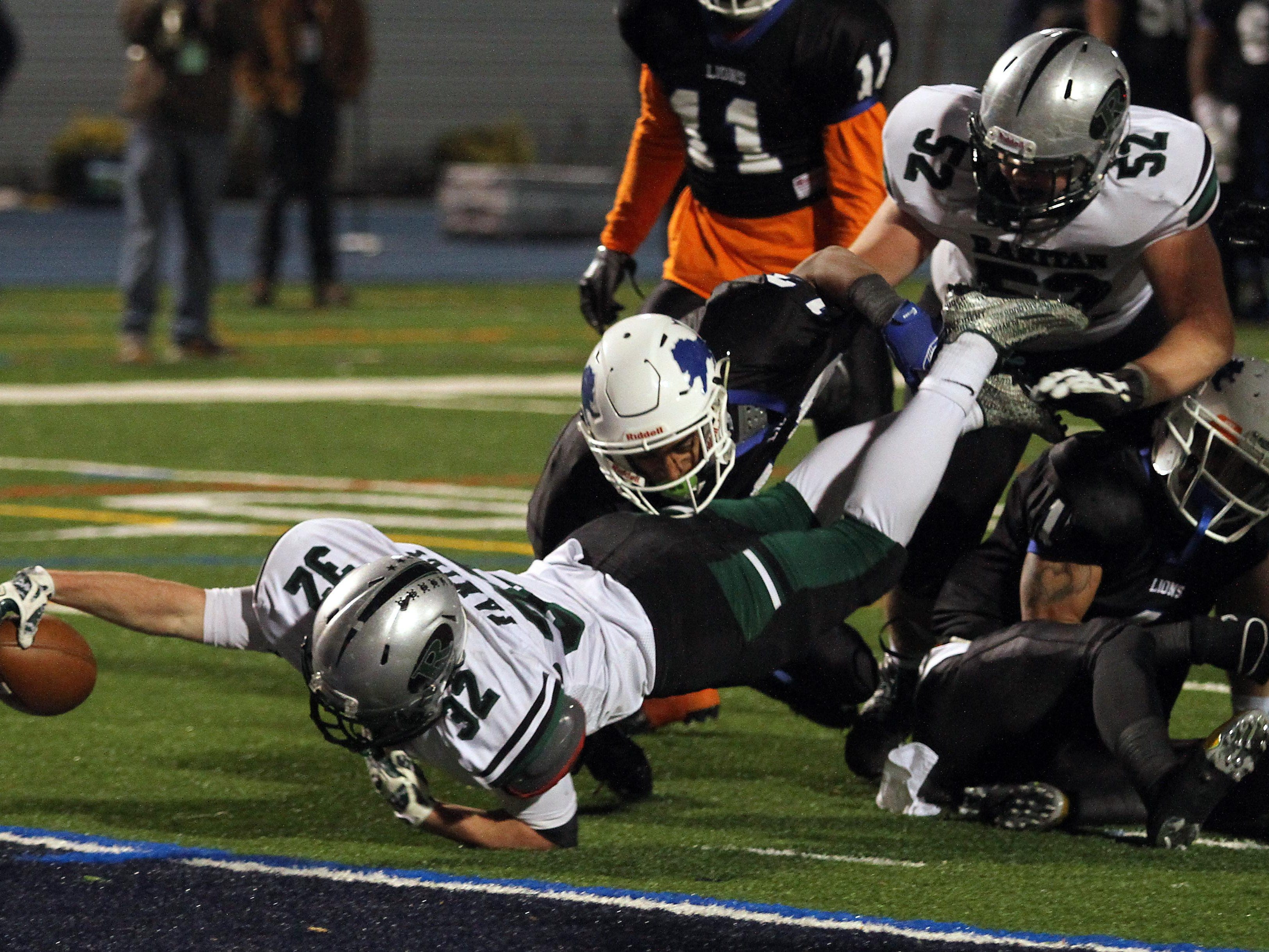 Raritan running back Derek Ernst dives into the end zone for a touchdown in the first half vs. Lincoln in the NJSIAA Central, Group Two Championship game at Kean University Alumni Stadium. December 5, 2015, Union, NJ.