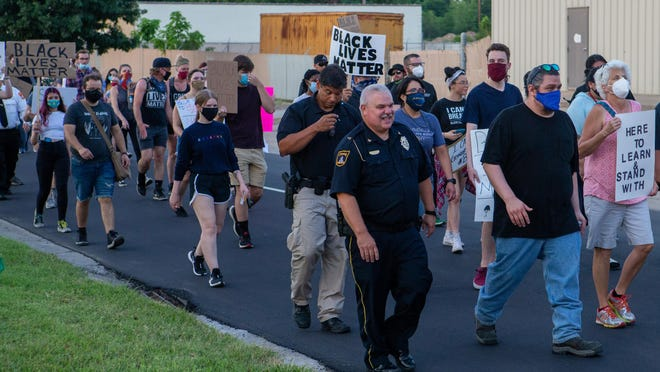 Topeka Police chief Bill Cochran joined mayor Michelle De La Isla and others in a march from the Capitol to the Brown v Board National Historic Site on June 16.