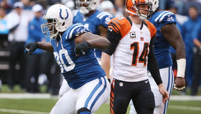 Colts defensive end Cory Redding celebrates a sack on Bengal quarterback Andy Dalton in the third quarter. Indianapolis hosted Cincinnati at Lucas Oil Stadium Sunday, October 19, 2014.