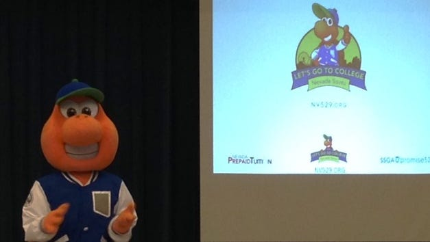 Sage, the College Savings Plan mascot talks to VVES students Nov. 5.