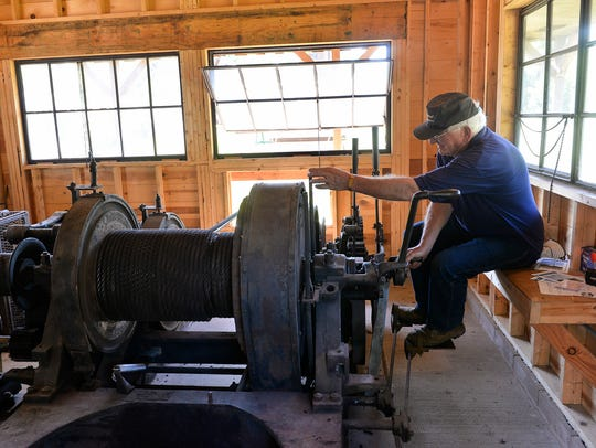 Operator Bob Ramler starts the drum hoists that operate