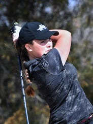 Emily Brennan tees off from number 9 during the Midwestern