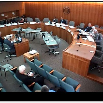 New Mexico State Lawmakers attend a meeting about nuclear