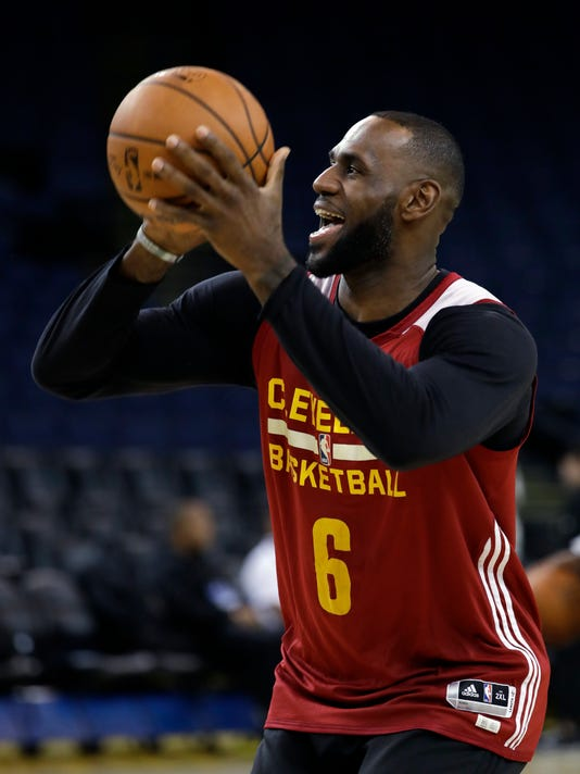 204f1fd3b Cleveland Cavaliers  LeBron James smiles as he shoots during an NBA  basketball practice
