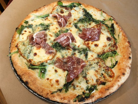 The Lombardy pizza at Pizzology features prosciutto, arugula, smoked mozzarella and parmesan reggiano.