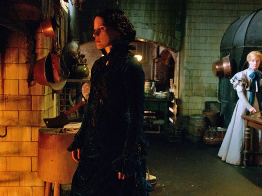"""Jessica Chastain, left, and Mia Wasikowska appear in a scene from """"Crimson Peak."""""""