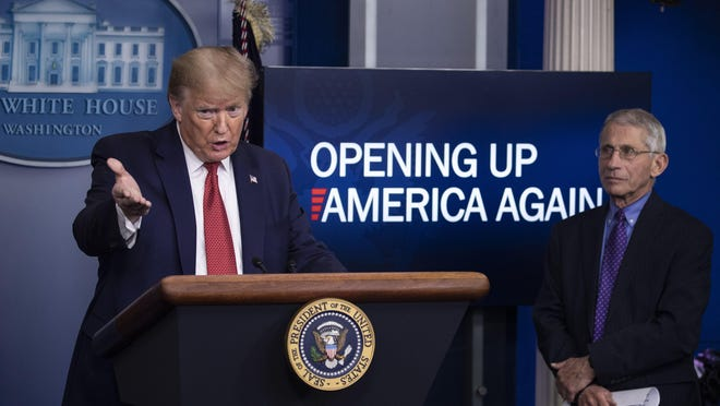 President Donald Trump speaks about the coronavirus, accompanied by Dr. Anthony Fauci, director of the National Institute of Allergy and Infectious Diseases, in the James Brady Press Briefing Room of the White House, Thursday, April 16, 2020, in Washington.