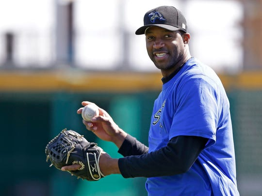 Retired NBA player Tracy McGrady smiles while working out at the Sugar Land Skeeters' baseball stadium in Sugar Land, Texas.
