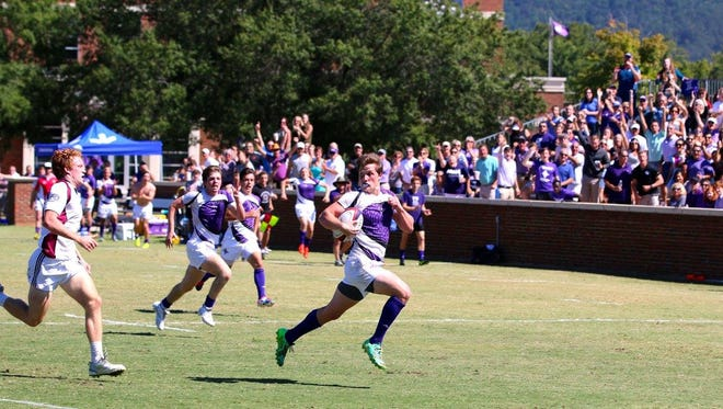 Furman University senior Adam Miller of Greenville, right, breaks free from the University of South Carolina's Cody Martinez of Greenville to score a try during the Paladins' 44-14 victory Oct. 1.