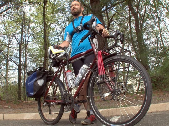 Dale Houck is shown with his bike Tuesday, May 5, 2015, as he prepares to commute from his job in Eatontown to home in Red Bank.