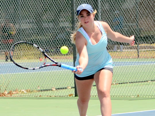 Hobbs' Amber Seay keeps the ball in play at the Cavern City tennis tournament Saturday.