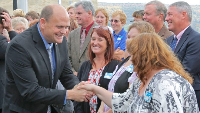 U.S. Rep. Tom Reed greets some well-wishers while visiting Schuyler Hospital in October.