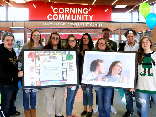 Students from the human sexuality course at Corning Community College created posters for Thursday's Health & Wellness Expo. From left,  Leif Allen, Claire Murphy, Sara Cilinio, Mary Kate Van Houten, Michele Dinicola, Shannon Nugent, Ramel Powers, Andrew Kessler and Sara Morrissette. Not pictured is Cody Lawrence.
