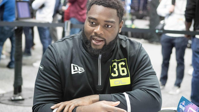 Michigan offensive lineman Mike Onwenu (OL36) speaks to the media during the 2020 NFL Combine in the Indianapolis Convention Center on Feb. 26, 2020.