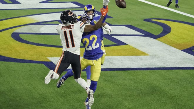 Los Angeles Rams cornerback Troy Hill (22) tips a pass in the end zone intended for Chicago Bears wide receiver Darnell Mooney (11) during the second half of an NFL football game Monday, Oct. 26, 2020, in Inglewood, Calif. The ball was caught by Rams safety Taylor Rapp, behind, for a touchback.
