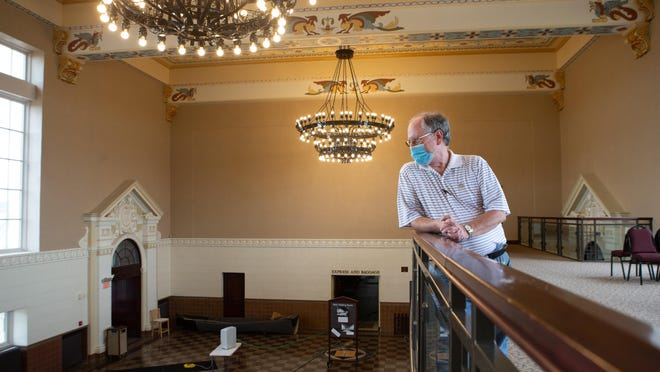 Bob St. John, chair of the Railroad Heritage board of trustees, looks out from a balcony over Great Overland Station's main hall. The station, 701 N. Kansas Ave., is now being leased by Shawnee County.