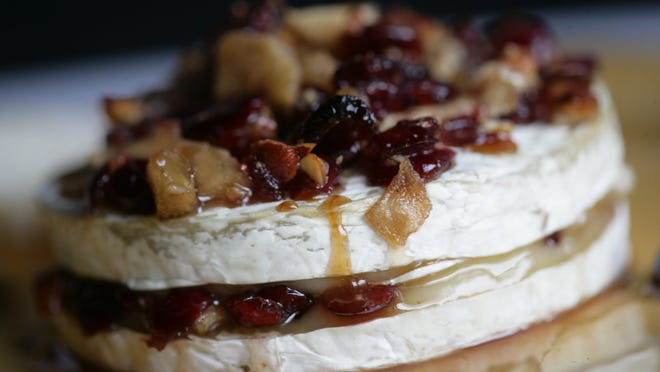 Brie makes an excellent and elegant appetizer for the New Year's celebration. Here is chutney baked brie made with sweetened cranberries, pecans and apples.
