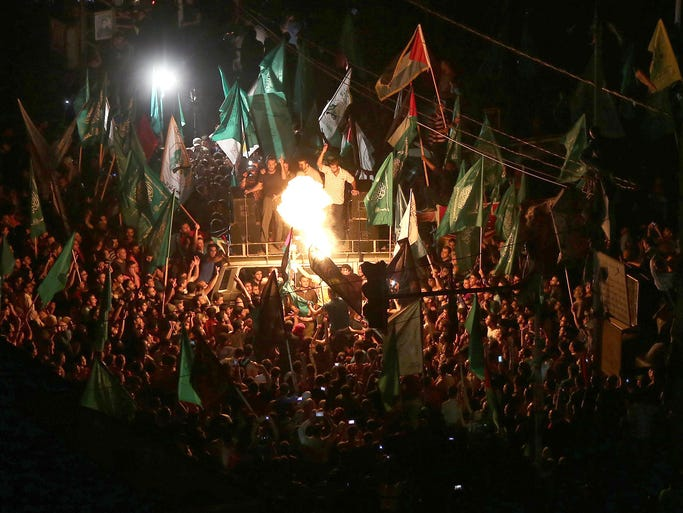 Palestinians celebrate the announcement of a cease-fire on Aug. 26 in Gaza City. Palestinian President Mahmoud Abbas announced an Egyptian-brokered cease-fire proposal to end seven weeks of fighting between Israel and militant groups in the Gaza Strip.