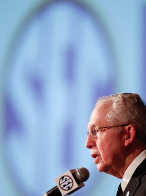 SEC commissioner Mike Slive talks with the media last July during the 2013 SEC football media days at the Hyatt Regency