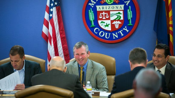 12/4/2013 -- 1203131003ml PNI1208-met politics chairman -- Maricopa County Board of Supervisors Chairman Andy Kunasek (cq), middle, and other Supervisors meet for a budget presentation for the Treasurer's Office at the Maricopa County Administration Building in downtown Phoenix on Wednesday, December 4, 2013. Michael Schennum / The Arizona Republic