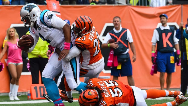Carolina Panthers quarterback Cam Newton (1) runs with the ball to score a touchdown as Cincinnati Bengals outside linebacker Vontaze Burfict (55) defends during the second half at Paul Brown Stadium.