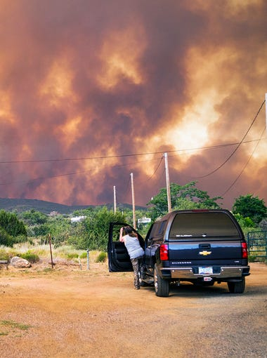 Don Sandy (left) watches the Goodwin Fire from his house in the town of Mayer on June 27, 2017.