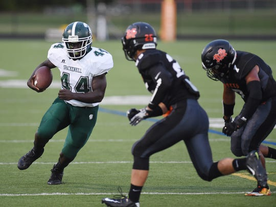 Spackenkill's Dhyquem Lewinson looks to lower his shoulder