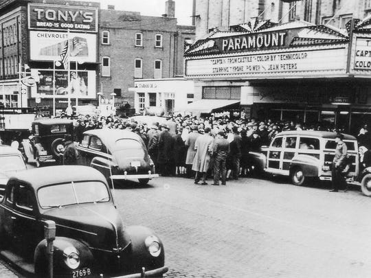 "Parking meters were in use on Front Street in this 1947 photo showing a crowd at the Paramount Theater to see"" Captain from Castile,"" starring Tyrone Power and Cesar Romero."