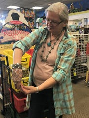 Specialties Games, Toys, Gifts Owner Linda Bell demonstrates