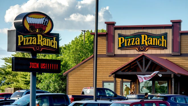 Patrons come and go Thursday, June 11, 2020 from the Pizza Ranch restaurant, 4114 N. Brandywine Drive, in Peoria. The restaurant has opened its buffet-style service despite restrictions imposed by the state in the wake of the coronavirus pandemic.