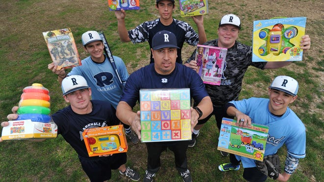 The Redwood baseball team is organizing a toy drive to benefit kids attending their feeder schools. Pictured on Thursday, December 3, 2015 are Cole Daniel, Chris Gonzalez, Josue Mendivil, Jace Chamberlin, Kameron Trevino and coach Dan Hydash.