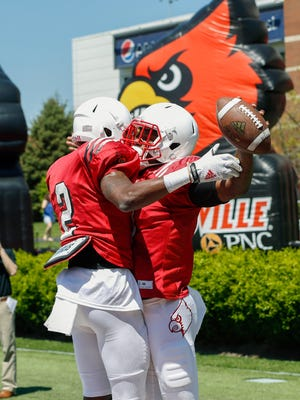 Louisville's Lamar Jackson, right, and Jamari Staples celebrate at the Spring game Saturday afternoon. 