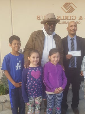 Cedric, center, recently gave $25,000 to the Boys & Girls Club of Camarillo.